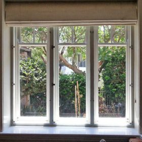 Euro Glazing duble-glazed triple tall window, perfectly alligned to the existing fenestration to make the double glazing almost invisible